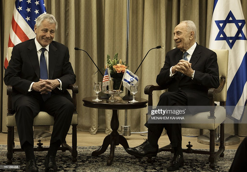 US Secretary of Defence Chuck Hagel (L) meets with Israeli President Shimon Peres at the President's office in Jerusalem on April 22, 2013. Hagel arrived in Israel at the start of a six-day regional tour, his first since taking over as Pentagon chief two months ago, which was likely to be dominated by concerns over Iran's nuclear programme and Syria's civil war.