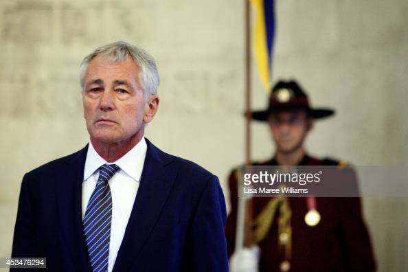Secretary of Defence Chuck Hagel pauses for a moments silence during a wreath laying ceremony on August 11 2014 in Sydney Australia US Sercretary of...