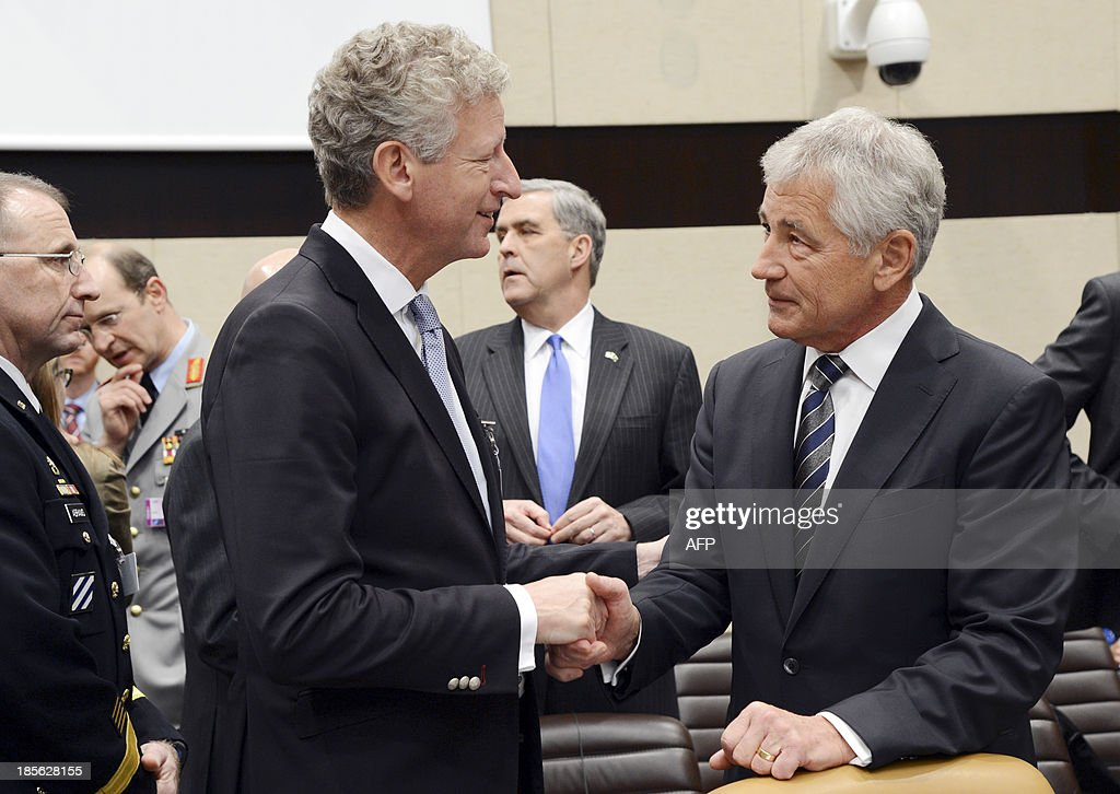 US Secretary of Defence Chuck Hagel (R) shakes hands with Belgium's Defence minister Pieter De Crem (L) prior to the start of the meeting NATO-ISAF (International Security Assistance Force) of defence ministers at the NATO headquarters in Brussels on October 23, 2013. NATO defence ministers are due to discuss the Afghan operation as part of preparations for the withdrawal of all troops next year.