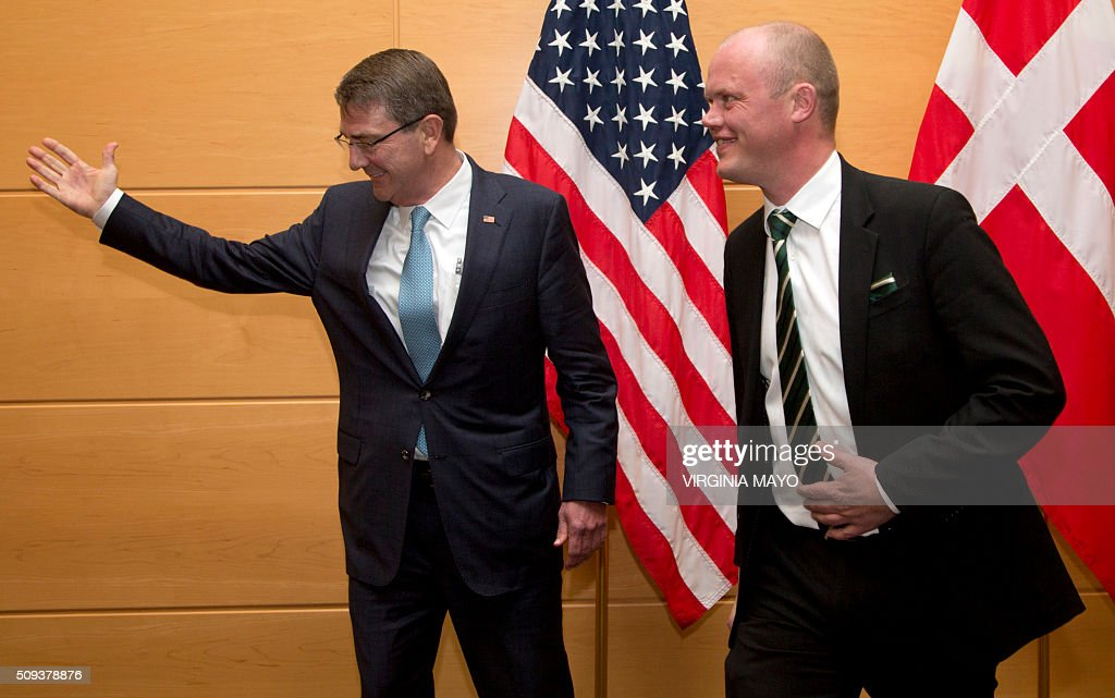 US Secretary of Defense Ash Carter (L) gestures next to Danish Defense Minister Peter Christensen before a bilateral meeting at NATO headquarters in Brussels on February 10, 2016. NATO defence ministers convene a two-day meeting to discuss current defense issues and whether the Alliance should take a more direct role in dealing with its gravest migrant crisis since Worl War II. / AFP / POOL / Virginia Mayo