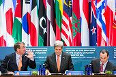 S Secretary of Defense Ash Carter left US Secretary of State John Kerry center and Special Presidential Envoy for the Global Coalition to Counter...