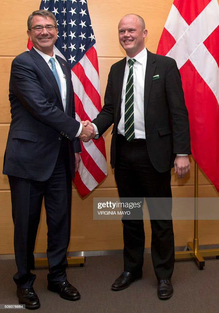 US Secretary of Defense Ash Carter (L) shakes hands with Danish Defense Minister Peter Christensen before a bilateral meeting at NATO headquarters in Brussels on February 10, 2016. NATO defence ministers convene a two-day meeting to discuss current defense issues and whether the Alliance should take a more direct role in dealing with its gravest migrant crisis since Worl War II. / AFP / POOL / Virginia Mayo