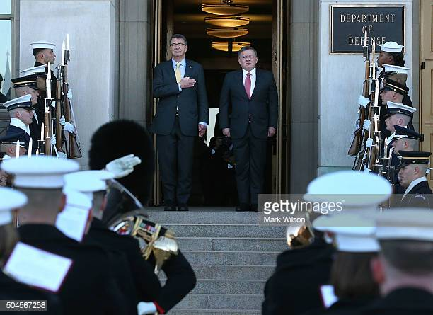 S Secretary of Defense Ash Carter welcomes Jordan's King Abdullah II during his arrival to the Pentagon January 11 2016 in Arlington Virginia King...