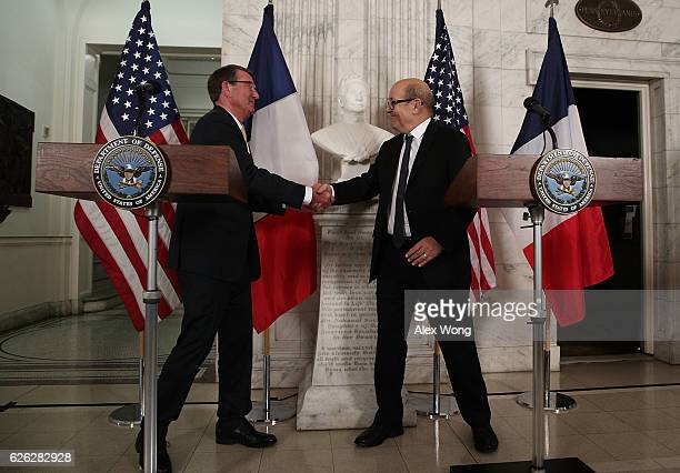 S Secretary of Defense Ashton Carter and French Minister of Defense JeanYves Le Drian shake hands prior to their fourth meeting in the past five...