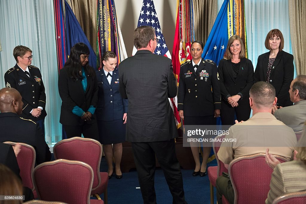 US Secretary of Defense Ashton Carter claps for recipients of the 2016 Exceptional Sexual Assault Response Coordinators Award at the Pentagon April 28, 2016 in Washington, DC. / AFP / Brendan Smialowski