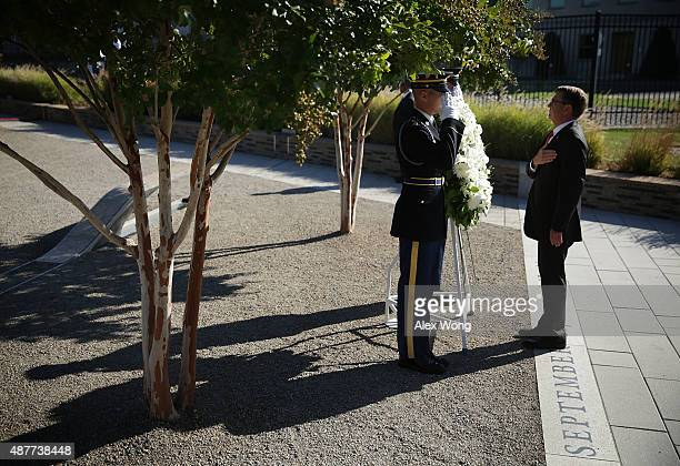 S Secretary of Defense Ashton Carter lays a wreath during an observance ceremony at the Pentagon Memorial September 11 2015 in Arlington Virginia The...