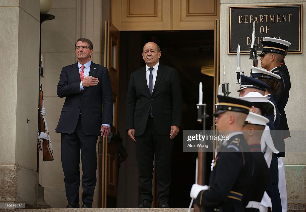 U.S. Secretary of Defense Ashton Carter (L) participates in an honor cordon to welcome France Minister of Defense Jean-Yves Le Drian (R) to visit the Pentagon July 6, 2015 in Arlington, Virginia. The two counterparts will conduct a joint press conference later in the day.