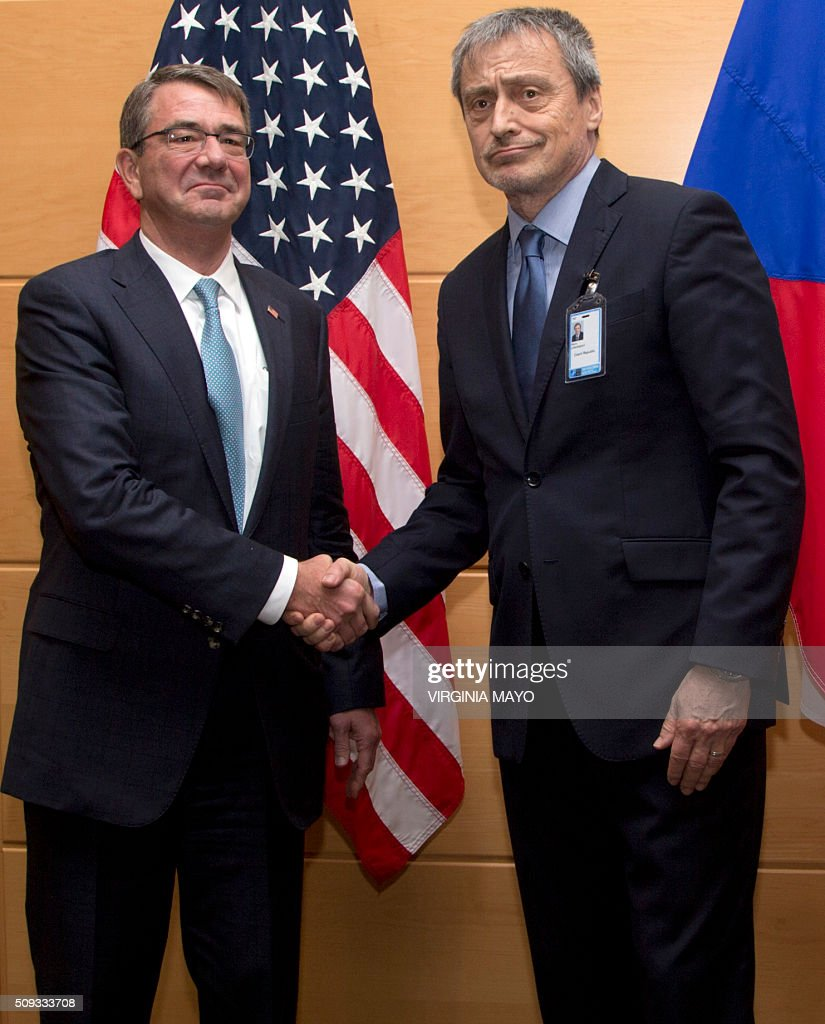 U.S. Secretary of Defense Ashton Carter(L) shakes hands with Czech Republic's Defense Minister Martin Stropnicky prior to a meeting at NATO headquarters in Brussels on February 10 2016. NATO defense ministers convene a two-day meeting to discuss current defense issues and whether the Alliance should take a more direct role in dealing with its gravest migrant crisis since WWII. / AFP / POOL / Virginia Mayo
