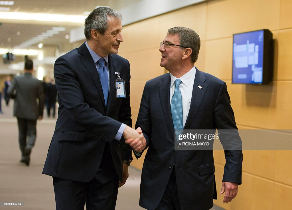 U.S. Secretary of Defense Ashton Carter (R) shakes hands with Czech Republic's Defense Minister Martin Stropnicky prior to a meeting at NATO headquarters in Brussels on February 10, 2016. NATO defense ministers convene a two-day meeting to discuss current defense issues and whether the Alliance should take a more direct role in dealing with its gravest migrant crisis since WWII. / AFP / POOL / Virginia Mayo