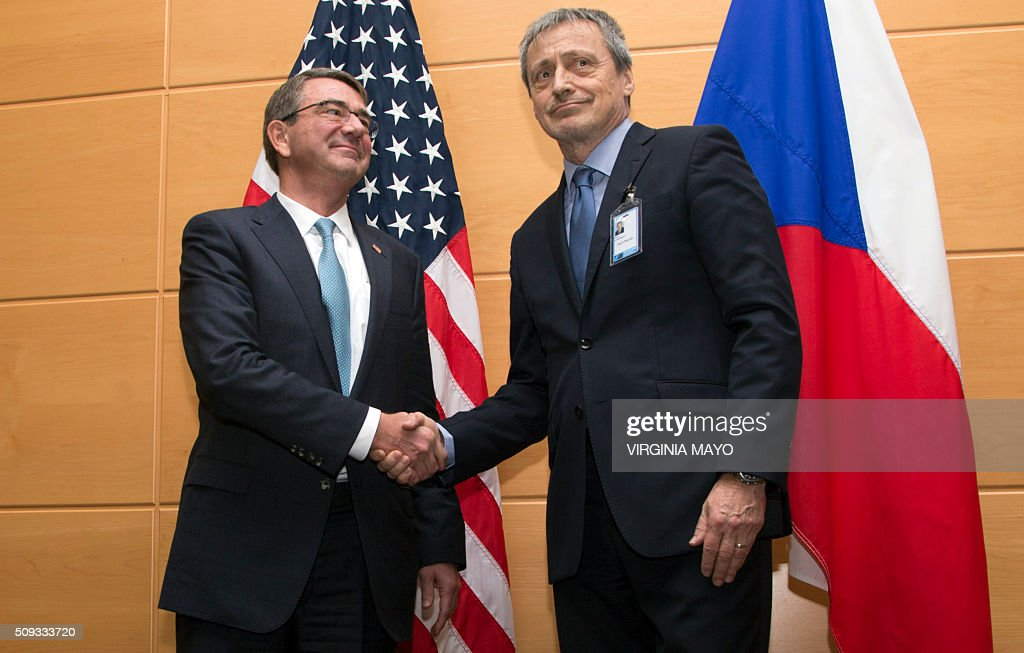 U.S. Secretary of Defense Ashton Carter(L) shakes hands with Czech Republic's Defense Minister Martin Stropnicky prior to a meeting at NATO headquarters in Brussels on February 10, 2016. NATO defense ministers convene a two-day meeting to discuss current defense issues and whether the Alliance should take a more direct role in dealing with its gravest migrant crisis since WWII. / AFP / POOL / Virginia Mayo