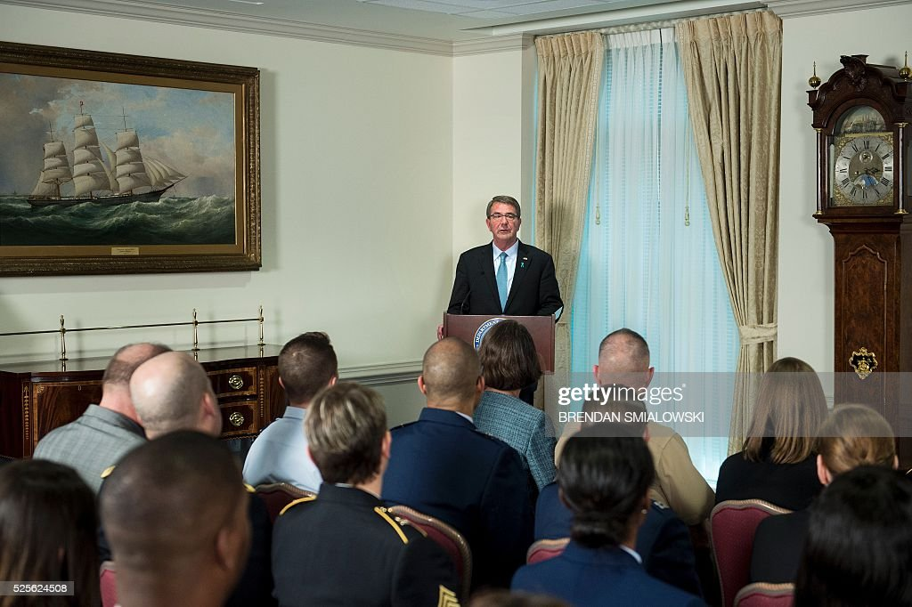US Secretary of Defense Ashton Carter speaks during an event to honor recipients of the 2016 Exceptional Sexual Assault Response Coordinators Award at the Pentagon on April 28, 2016 in Washington, DC. / AFP / Brendan Smialowski