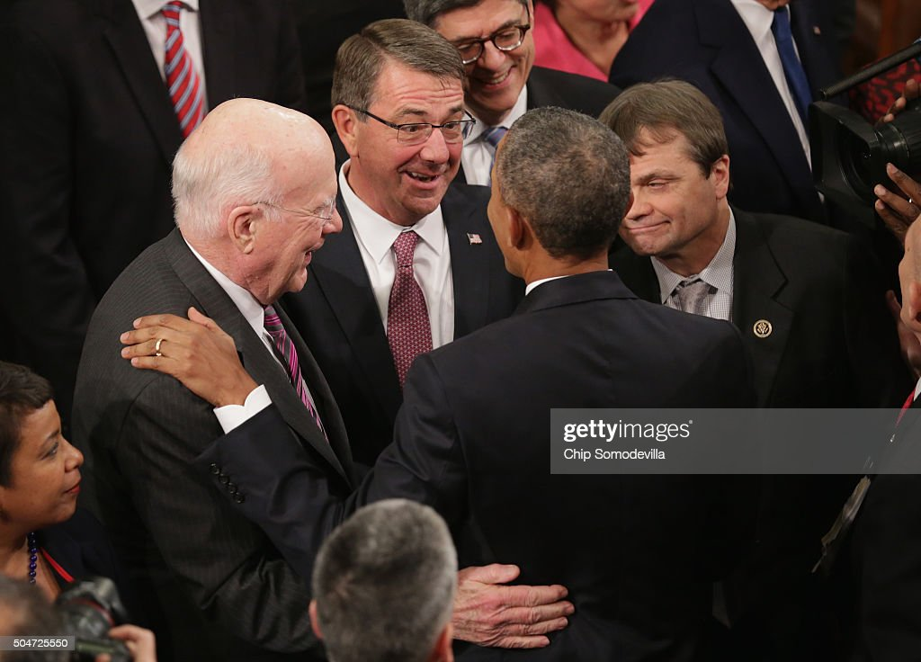 US Secretary of Defense Ashton Carter (C) speaks with US President Barack Obama after delivering the State of the Union speech before members of Congress in the House chamber of the U.S. Capitol January 12, 2016 in Washington, DC. In his last State of the Union, President Obama reflected on the past seven years in office and spoke on topics including climate change, gun control, immigration and income inequality.