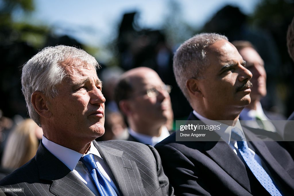 Secretary of Defense <a gi-track='captionPersonalityLinkClicked' href=/galleries/search?phrase=Chuck+Hagel&family=editorial&specificpeople=504963 ng-click='$event.stopPropagation()'>Chuck Hagel</a> and Attorney General <a gi-track='captionPersonalityLinkClicked' href=/galleries/search?phrase=Eric+Holder&family=editorial&specificpeople=1060367 ng-click='$event.stopPropagation()'>Eric Holder</a> listen as President Barack Obama introduces Jeh Johnson as his nominee to be the next Secretary of the Department of Homeland Security, in the Rose Garden of the White House, October 18, 2013 in Washington, DC. The Department of Homeland Security has been without a Senate-confirmed leader for six weeks.