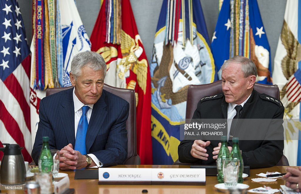 US Secretary of Defense Chuck Hagel(L) and Chairman Joint Chiefs of Staff Martin Dempsey meet with other senior US military leaders at the Pentagon on March 1, 2013, in Washington, DC. AFP Photo/Paul J. Richards