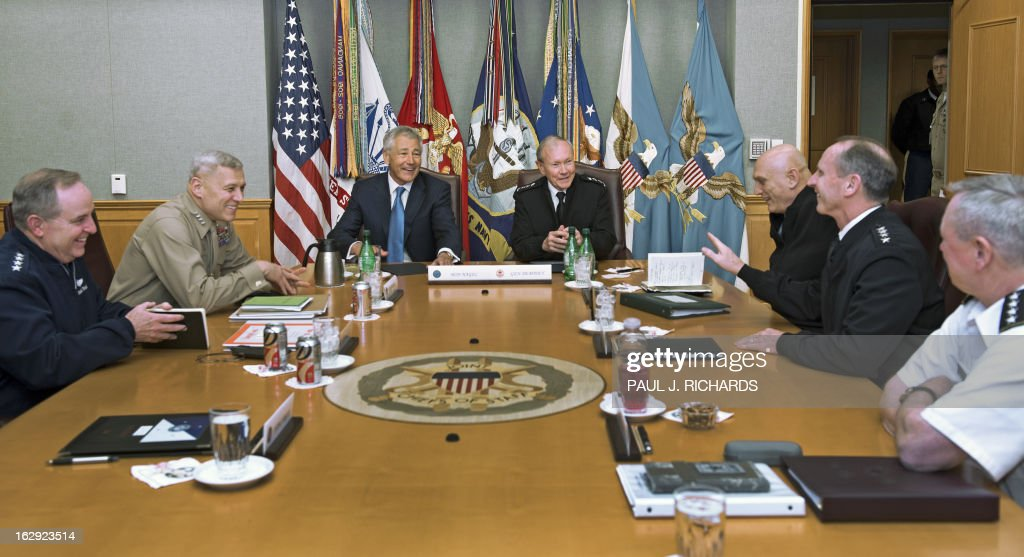 US Secretary of Defense Chuck Hagel (C, L) and Chairman Joint Chiefs of Staff Martin Dempsey (C, R) meet with other senior US military leaders inside the secure conference room known as 'The Tank' at the Pentagon in Washington on March 1, 2013. On the left are Gen. Mark Welsh (L) and Gen. Jay Paxton (2nd L), and on the right are Gen. Frank Grass (R), Adm. Jon Greenert (2nd R), and Gen. Ray Ordierno (3rd R). AFP PHOTO/Paul J. Richards