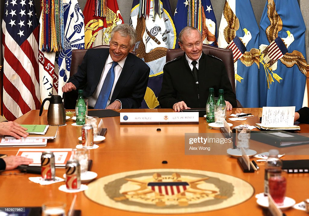 U.S. Secretary of Defense <a gi-track='captionPersonalityLinkClicked' href=/galleries/search?phrase=Chuck+Hagel&family=editorial&specificpeople=504963 ng-click='$event.stopPropagation()'>Chuck Hagel</a> (L) and Chairman of the Joint Chiefs of Staff General <a gi-track='captionPersonalityLinkClicked' href=/galleries/search?phrase=Martin+Dempsey&family=editorial&specificpeople=2116621 ng-click='$event.stopPropagation()'>Martin Dempsey</a> (R) share a moment during a meeting at the Joint Chiefs Conference Room, also known as the 'tank,' March 1, 2013 at the Pentagon in Arlington, Virginia. Secretary Hagel participated in a meet-and-greet with the members of the Joint Chiefs of Staff.