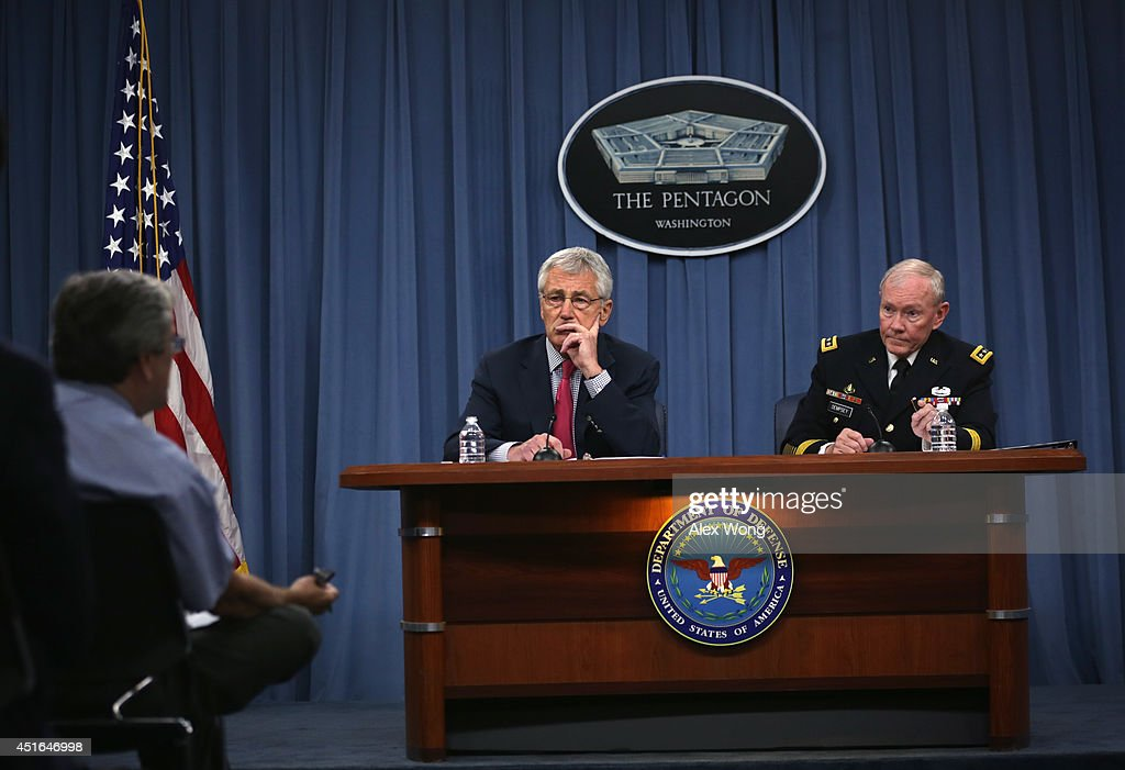Secretary of Defense <a gi-track='captionPersonalityLinkClicked' href=/galleries/search?phrase=Chuck+Hagel&family=editorial&specificpeople=504963 ng-click='$event.stopPropagation()'>Chuck Hagel</a> (L) and Chairman of the Joint Chiefs of Staff Gen. <a gi-track='captionPersonalityLinkClicked' href=/galleries/search?phrase=Martin+Dempsey&family=editorial&specificpeople=2116621 ng-click='$event.stopPropagation()'>Martin Dempsey</a> (R) brief members of the media July 3, 2014 at the Pentagon in Arlington, Virginia. Secretary Hagel and General Dempsey discussed various topics including the current situations in Iraq.