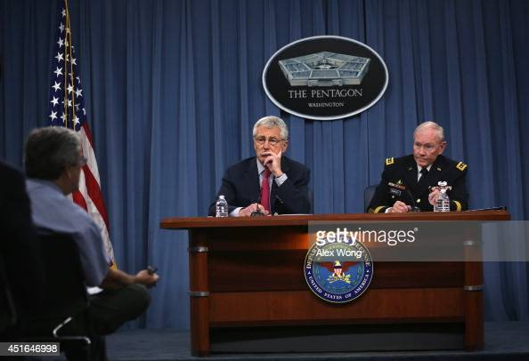 Secretary of Defense Chuck Hagel and Chairman of the Joint Chiefs of Staff Gen Martin Dempsey brief members of the media July 3 2014 at the Pentagon...
