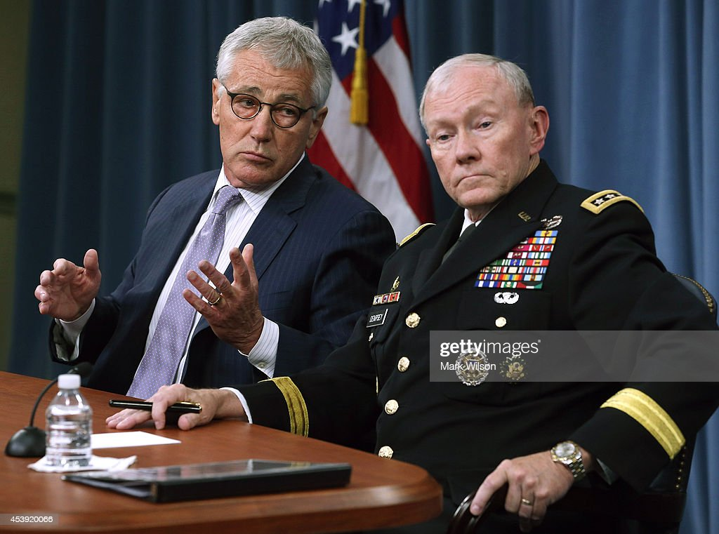 U.S. Secretary of Defense <a gi-track='captionPersonalityLinkClicked' href=/galleries/search?phrase=Chuck+Hagel&family=editorial&specificpeople=504963 ng-click='$event.stopPropagation()'>Chuck Hagel</a> (L) and Chairman of the Joint Chiefs of Staff General <a gi-track='captionPersonalityLinkClicked' href=/galleries/search?phrase=Martin+Dempsey&family=editorial&specificpeople=2116621 ng-click='$event.stopPropagation()'>Martin Dempsey</a> speak to the media during a press briefing at the Pentagon August 21, 2014 in Arlington, Virginia. Secretary Hagel spoke about the terror group ISIS and the situation in Iraq.