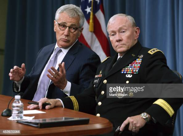 S Secretary of Defense Chuck Hagel and Chairman of the Joint Chiefs of Staff General Martin Dempsey speak to the media during a press briefing at the...