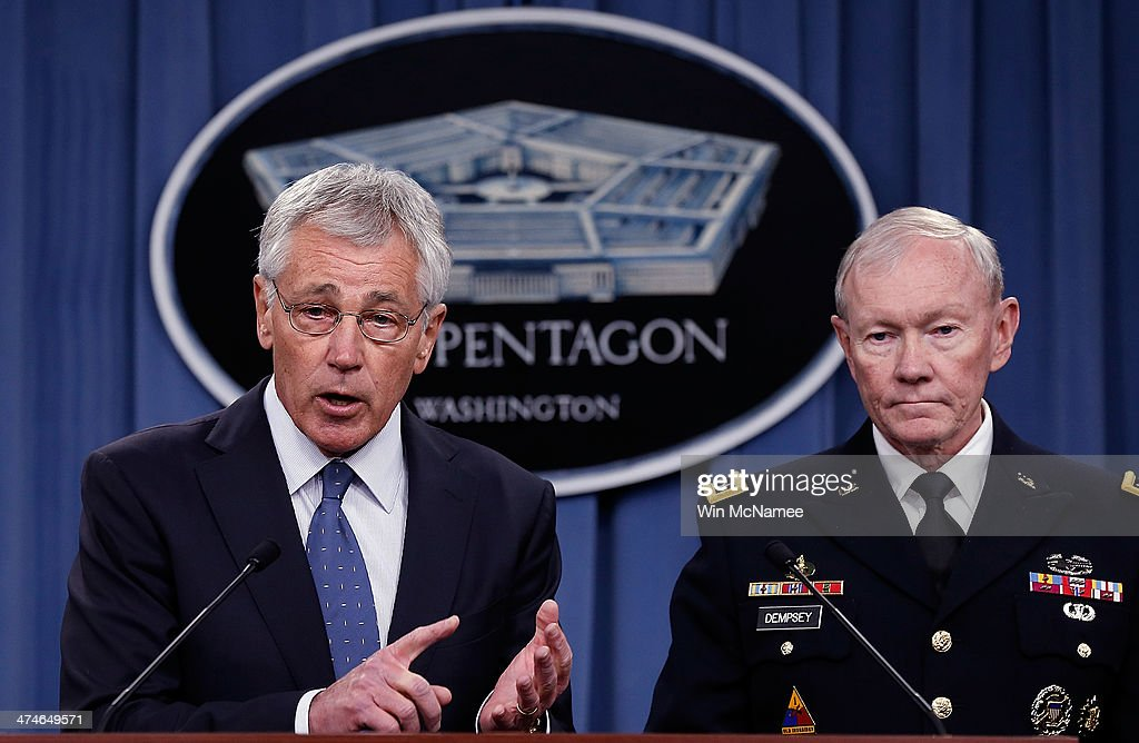 U.S. Secretary of Defense Chuck Hagel (L) and Chairman of the Joint Chiefs of Staff Gen. Martin Dempsey (R) answer questions during a press conference at the Pentagon February 24, 2014 in Arlington, Virginia. Hagel and Dempsey spoke about the upcoming Defense Department budget requests during the press conference. A proposal released February 24, plans to shrink the U.S. Army to pre-World War II levels.