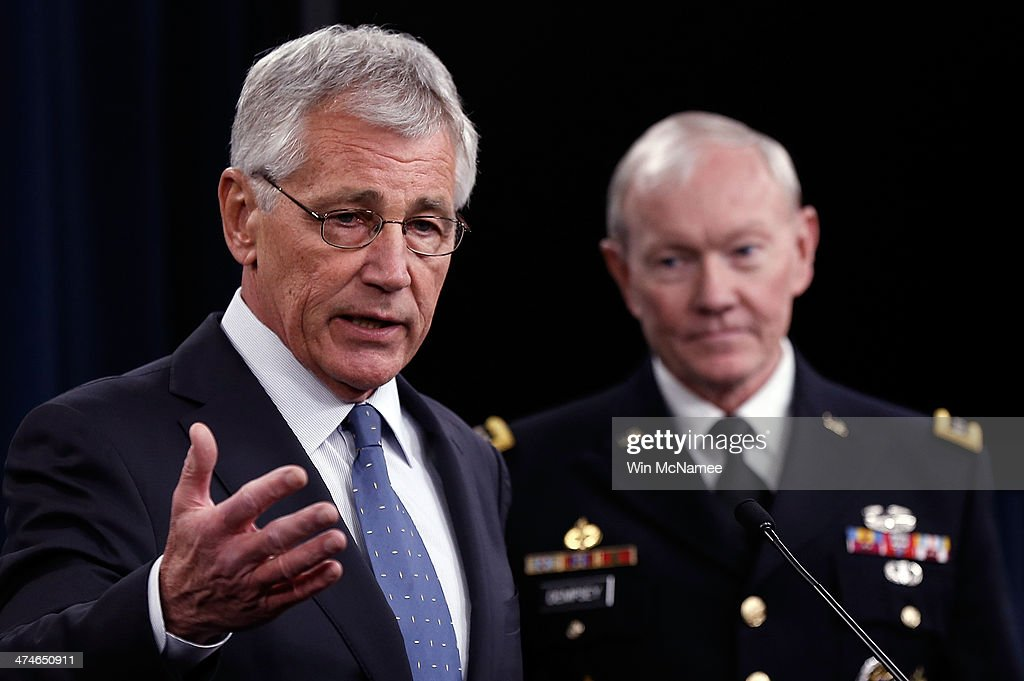 U.S. Secretary of Defense <a gi-track='captionPersonalityLinkClicked' href=/galleries/search?phrase=Chuck+Hagel&family=editorial&specificpeople=504963 ng-click='$event.stopPropagation()'>Chuck Hagel</a> (L) and Chairman of the Joint Chiefs of Staff Gen. <a gi-track='captionPersonalityLinkClicked' href=/galleries/search?phrase=Martin+Dempsey&family=editorial&specificpeople=2116621 ng-click='$event.stopPropagation()'>Martin Dempsey</a> (R) answer questions during a press conference at the Pentagon February 24, 2014 in Arlington, Virginia. Hagel and Dempsey spoke about the upcoming Defense Department budget requests during the press conference. A proposal released February 24, plans to shrink the U.S. Army to pre-World War II levels.