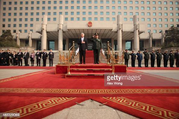 S Secretary of Defense Chuck Hagel and Chinese Minister of Defense Chang Wanquan listen to the US national anthem during a welcome ceremony at the...