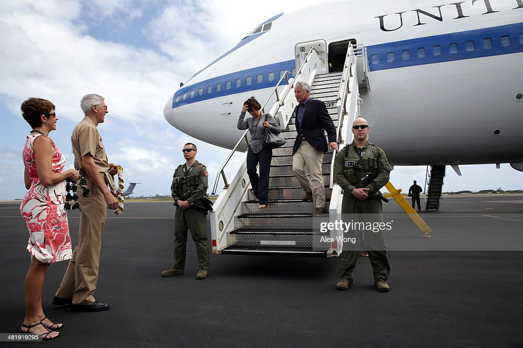 U.S. Secretary of Defense <a gi-track='captionPersonalityLinkClicked' href=/galleries/search?phrase=Chuck+Hagel&family=editorial&specificpeople=504963 ng-click='$event.stopPropagation()'>Chuck Hagel</a> (R) and his wife Lilibet Hagel (2nd R) are welcomed by Commander of U.S. Pacific Command Admiral Samuel Locklear (2nd L) and his wife Pamela Locklear (L) with a lei-greeting during an arrival at Hickam Field of Joint Base Pearl Harbor April 1, 2014 in Honolulu, Hawaii. Secretary Hagel is in Hawaii to host a meeting of defense ministers from the Association of Southeast Asian Nations (ASEAN) on April 1 to 3.