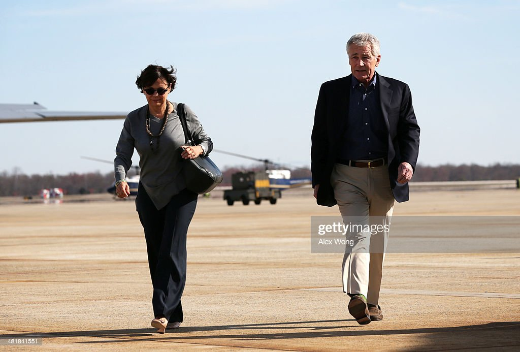 U.S. Secretary of Defense <a gi-track='captionPersonalityLinkClicked' href=/galleries/search?phrase=Chuck+Hagel&family=editorial&specificpeople=504963 ng-click='$event.stopPropagation()'>Chuck Hagel</a> and his wife Lilibet walk on the tarmac prior to their departure April 1, 2014 at Joint Base Andrews, Maryland. Secretary Hagel is heading to Hawaii to host a meeting of defense ministers from the Association of Southeast Asian Nations (ASEAN) on April 1 to 3.