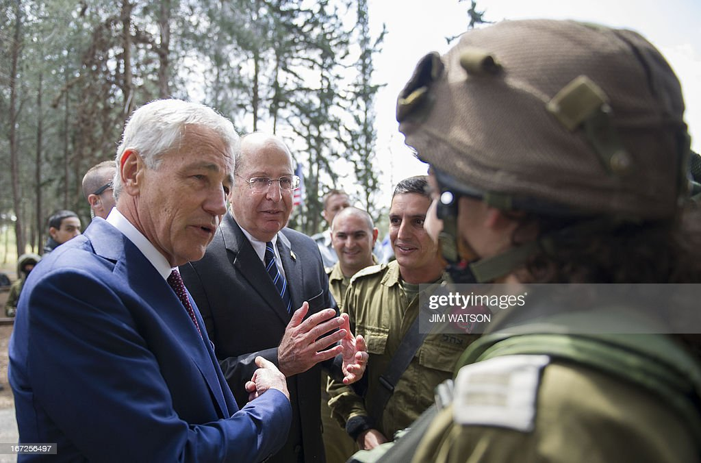 US Secretary of Defense Chuck Hagel (L) and Israeli Defense Minister Moshe Yaalon (2nd L) speak with Israeli soldiers during a visit to a military K-9 unit training site at an army base near Tel Aviv, on April 23, 2013. Defence Secretary Chuck Hagel met Israel's Benjamin Netanyahu at the end of a three-day trip which saw him touting strong backing for Israel despite differences over Iran's nuclear project.