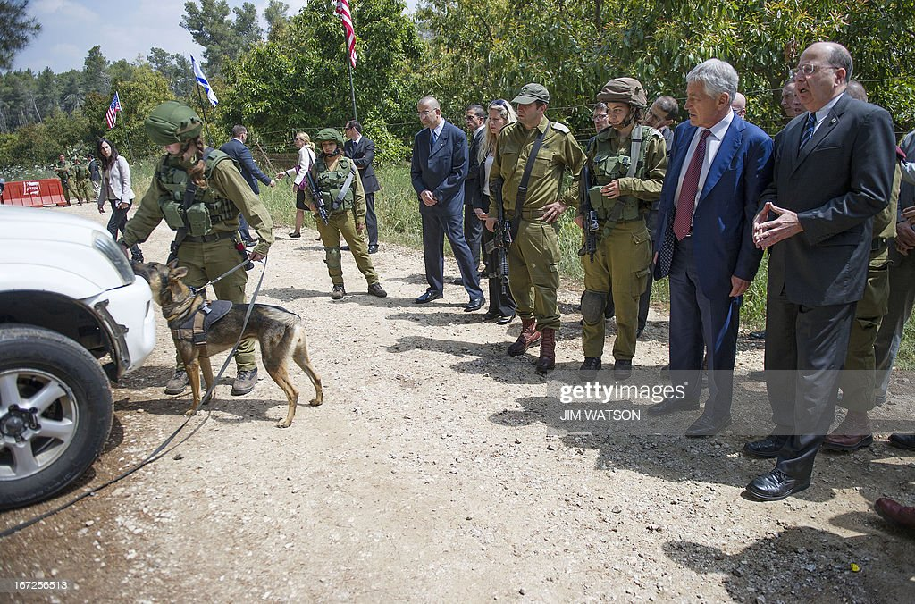 US Secretary of Defense Chuck Hagel (2nd R) and Israeli Defense Minister Moshe Yaalon (R) watch an Israeli military K-9 unit train at an army base near Tel Aviv, on April 23, 2013. Defence Secretary Chuck Hagel met Israel's Benjamin Netanyahu at the end of a three-day trip which saw him touting strong backing for Israel despite differences over Iran's nuclear project. AFP PHOTO/POOL/JIM WATSON
