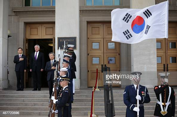 S Secretary of Defense Chuck Hagel and National Defense Minister of Korea Han Min Koo listen to national anthems during a honor cordon at the...