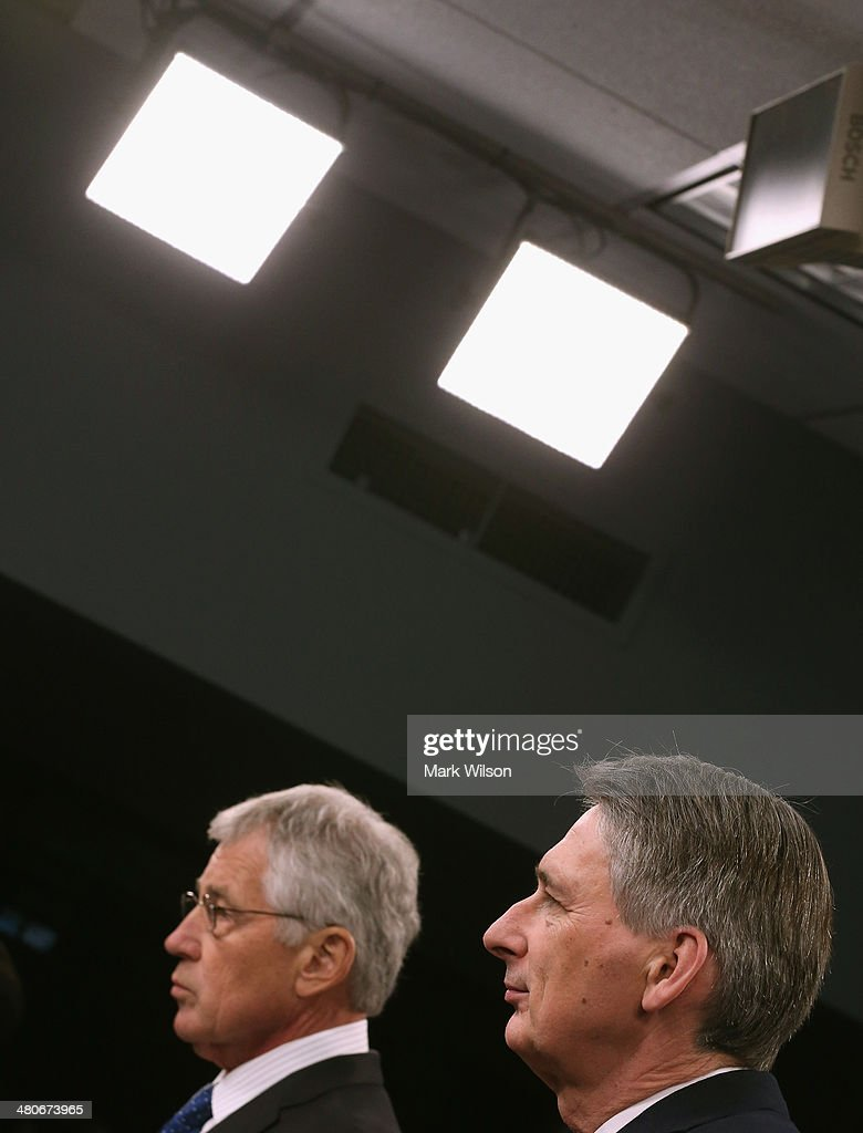 U.S. Secretary of Defense <a gi-track='captionPersonalityLinkClicked' href=/galleries/search?phrase=Chuck+Hagel&family=editorial&specificpeople=504963 ng-click='$event.stopPropagation()'>Chuck Hagel</a> (L) and United Kingdom Secretary of State for Defense <a gi-track='captionPersonalityLinkClicked' href=/galleries/search?phrase=Philip+Hammond&family=editorial&specificpeople=2486715 ng-click='$event.stopPropagation()'>Philip Hammond</a> answer questions from the media during a briefing at the Pentagon on March 26, 2014 in Arlington, Virginia. Secretary Hagel and Secretary Hammond participated in news conference where they fielded questions about the situation in Ukraine.