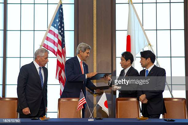 S Secretary of Defense Chuck Hagel and US Secretary of State John Kerry exchange signed documents with their Japanese counterparts Japanese Foreign...