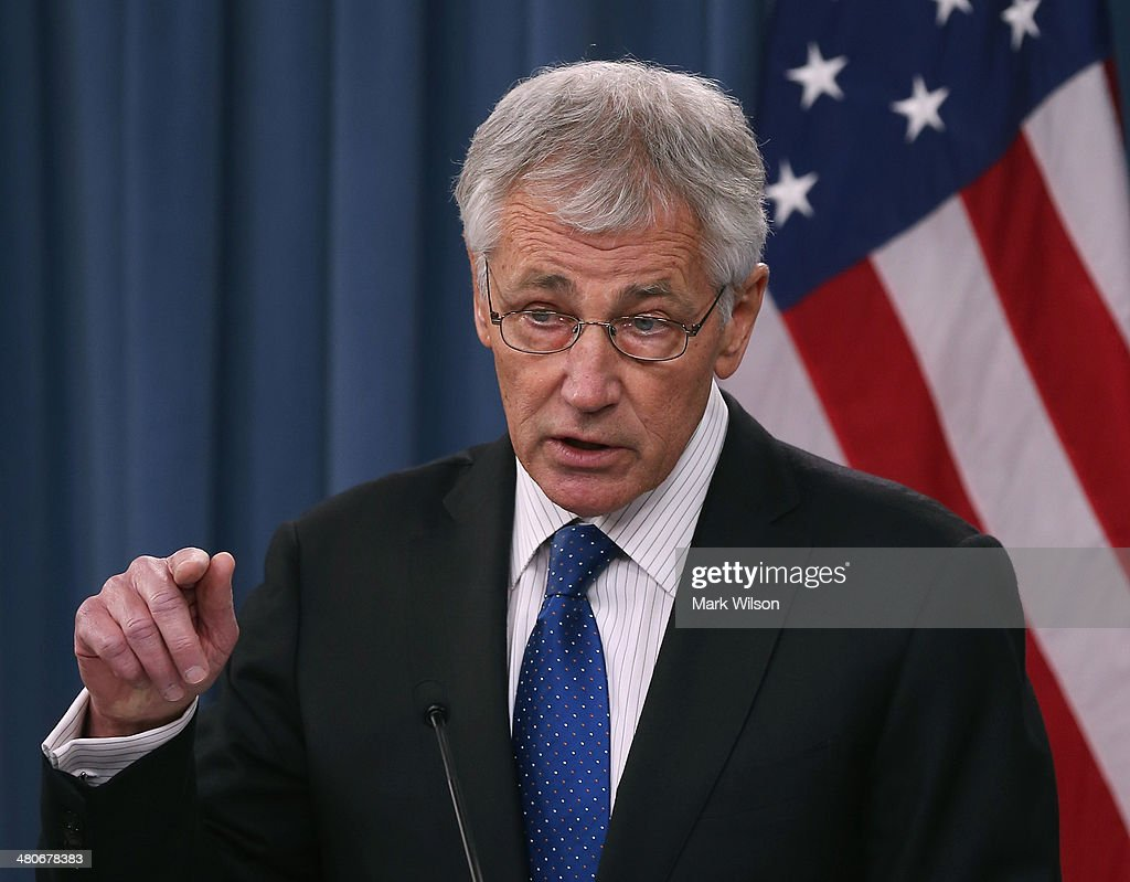 U.S. Secretary of Defense <a gi-track='captionPersonalityLinkClicked' href=/galleries/search?phrase=Chuck+Hagel&family=editorial&specificpeople=504963 ng-click='$event.stopPropagation()'>Chuck Hagel</a> answers questions during a briefing with United Kingdoms Secretary of State for Defense Philip Hammond at the Pentagon, on March 26, 2014 in Arlington, Virginia. Secretary Hagel and Secretary Hammond participated in news conference where they fielded questions about the situation in Ukraine.