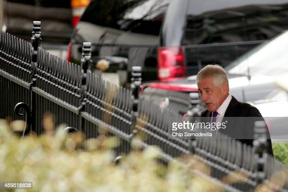 S Secretary of Defense Chuck Hagel arrives beforea press conference with President Barack Obama to announe Hagel's resignation at the White House...