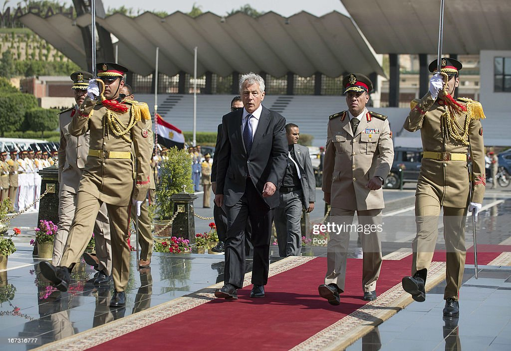 U.S. Secretary of Defense Chuck Hagel (C) arrives with an Egyptian army official before laying a wreath at the Tomb of the Unknown Soldier and the tomb of late president Anwar al-Sadat on April 24, 2013 in Cairo, Egypt. The U.S. Defense Secretary is on a six-day regional tour of the Middle East, his first since taking over as Pentagon chief two months ago. The visit is expected to be dominated by concerns over Iran's nuclear program and Syria's civil war.