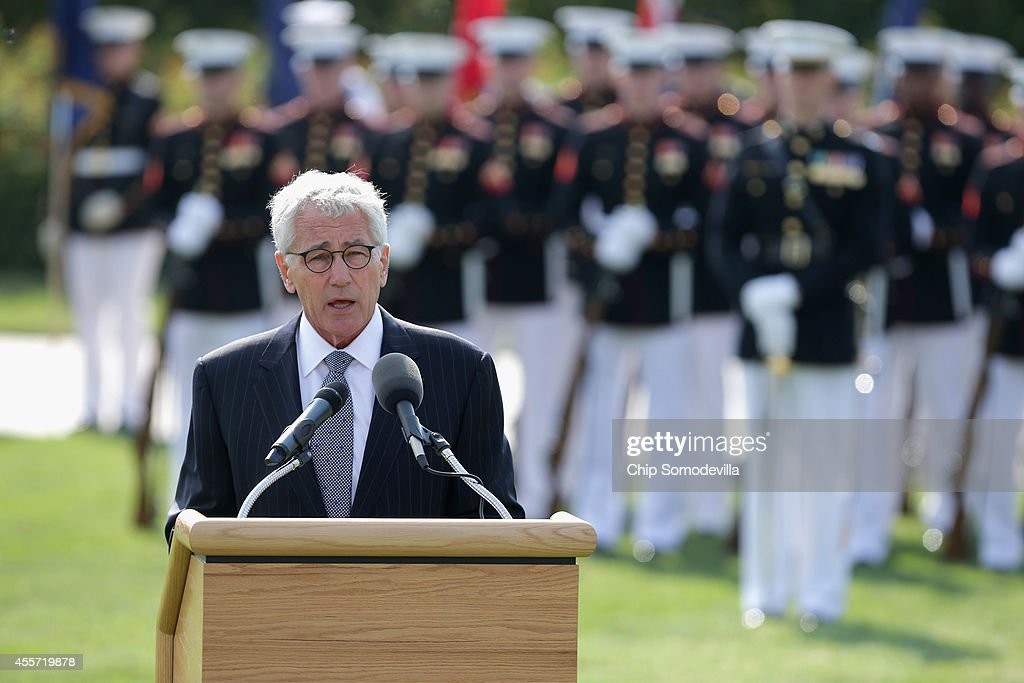 Secretary of Defense <a gi-track='captionPersonalityLinkClicked' href=/galleries/search?phrase=Chuck+Hagel&family=editorial&specificpeople=504963 ng-click='$event.stopPropagation()'>Chuck Hagel</a> delivers remarks during the Defense Department's National POW/MIA Recognition Day Ceremony on the Pentagon River Terrace Parade Field September 19, 2014 in Arlington, Virginia. The annual event honors prisoners of war, those missing in action and their families, and highlights the government's continued work to account for them.