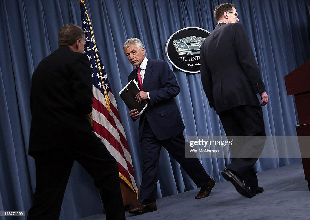 U.S. Secretary of Defense Chuck Hagel (C) departs after speaking on the U.S. missile defense system during a press briefing at the Pentagon March 15, 2013 in Arlington, Virginia. Hagel said the U.S. plans to boost its missile defense system due to concerns about the possible nuclear capabilities of North Korea.