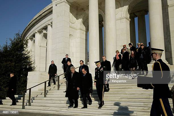 S Secretary of Defense Chuck Hagel French President Francois Hollande and Maj Gen Jeffrey S Buchanan commander of the US Army Military District of...