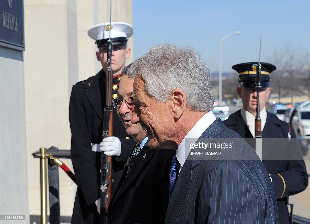US Secretary of Defense Chuck Hagel (R) greets Israel's Minister of Defense Ehud Barak during a honor cordon at the Pentagon in Washington, DC, on March 5, 2013. Barak warned Iran on March 3, that Israel would never allow Iranian leaders to develop a nuclear weapon, as he addressed a powerful US-Israel lobby AIPAC. AFP PHOTO/Jewel Samad