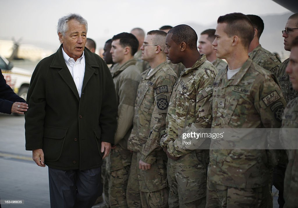 U.S. Secretary of Defense <a gi-track='captionPersonalityLinkClicked' href=/galleries/search?phrase=Chuck+Hagel&family=editorial&specificpeople=504963 ng-click='$event.stopPropagation()'>Chuck Hagel</a> greets U.S. Army troops on the tarmac of Kabul airport before boarding a flight to Washington on March 11, 2013 in Kabul, Afghanistan. Hagel ended his three day visit to Afghanistan on Monday, his first as Secretary of Defense.