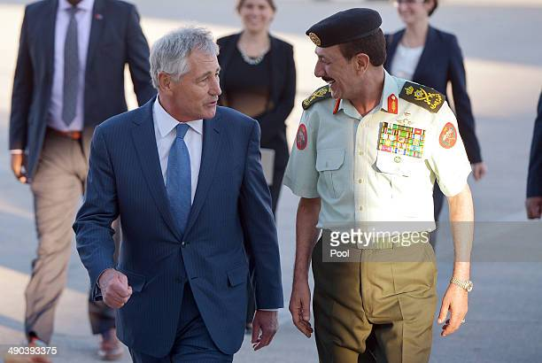 S Secretary of Defense Chuck Hagel is escorted by Jordan's Chairman of Defense Lieutenant General Mashal alZaben to a meeting upon his arrival at...