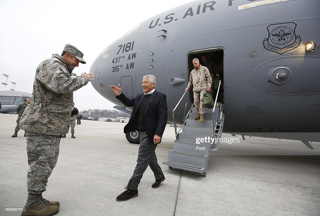 U.S. Secretary of Defense <a gi-track='captionPersonalityLinkClicked' href=/galleries/search?phrase=Chuck+Hagel&family=editorial&specificpeople=504963 ng-click='$event.stopPropagation()'>Chuck Hagel</a> (C) is greeted by U.S. General Philip Breedlove, U.S. Air Force Commander for Europe, upon Hagel's arrival at Ramstein Air Base on March 11, 2013 in Rhineland-Palatinate of Kaiserslautern, Germany. Hagel was on a three day visit to Afghanistan.