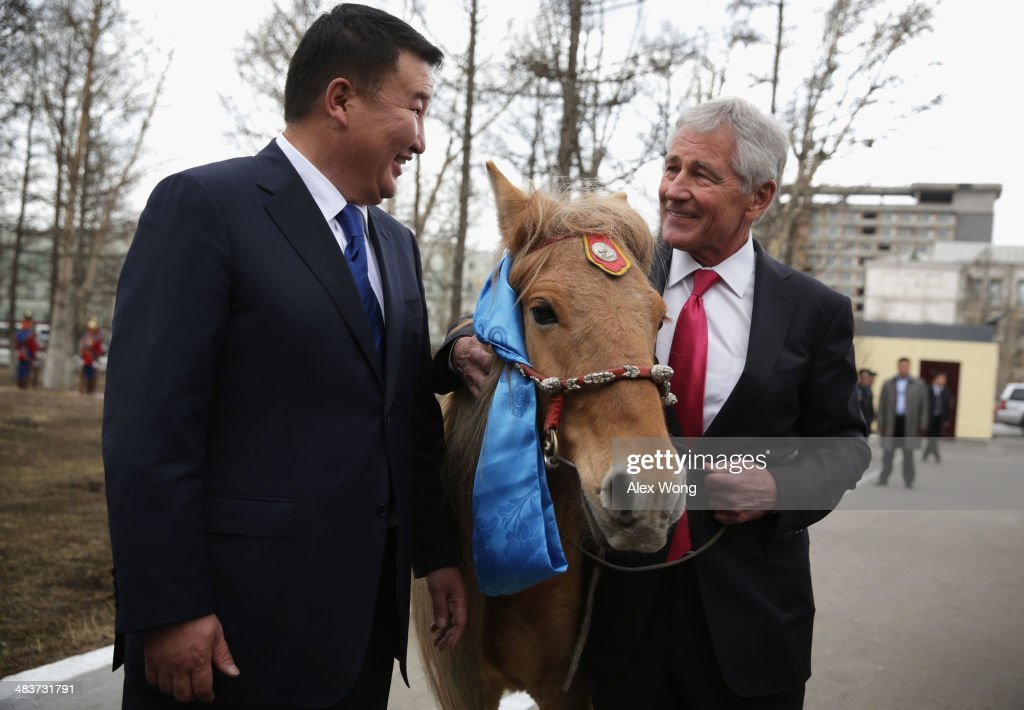 U.S. Secretary of Defense Chuck Hagel (R) is presented with a horse as a gift by Mongolian Defense Minister Dashdemberal Bat-Erdene (L) at the Mongolian Ministry of Defense April 10, 2014 in Ulaanbaatar, Mongolia. Secretary Hagel named the horse right away as 'Shamrock,' on the last stop of an Asian trip, the fourth since he took office, to Japan, China and Mongolia.