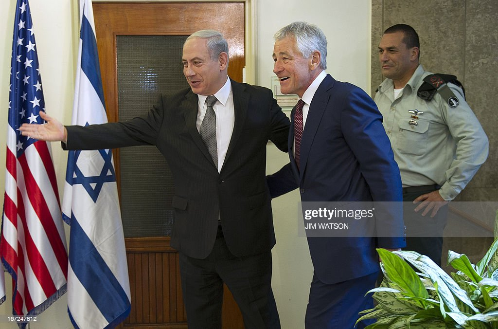 US Secretary of Defense Chuck Hagel (C) is welcomed by Israeli Prime Minister Benjamin Netanyahu (L) at his office in Jerusalem, on April 23, 2013, at the end of a three-day trip which saw him touting strong backing for Israel despite differences over Iran's nuclear project. AFP PHOTO/POOL/JIM WATSON