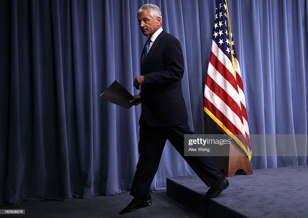 U.S. Secretary of Defense <a gi-track='captionPersonalityLinkClicked' href=/galleries/search?phrase=Chuck+Hagel&family=editorial&specificpeople=504963 ng-click='$event.stopPropagation()'>Chuck Hagel</a> leaves a news briefing March 1, 2013 at the Pentagon in Arlington, Virginia. Secretary Hagel spoke on the impact of the sequestration to the Department of Defense.