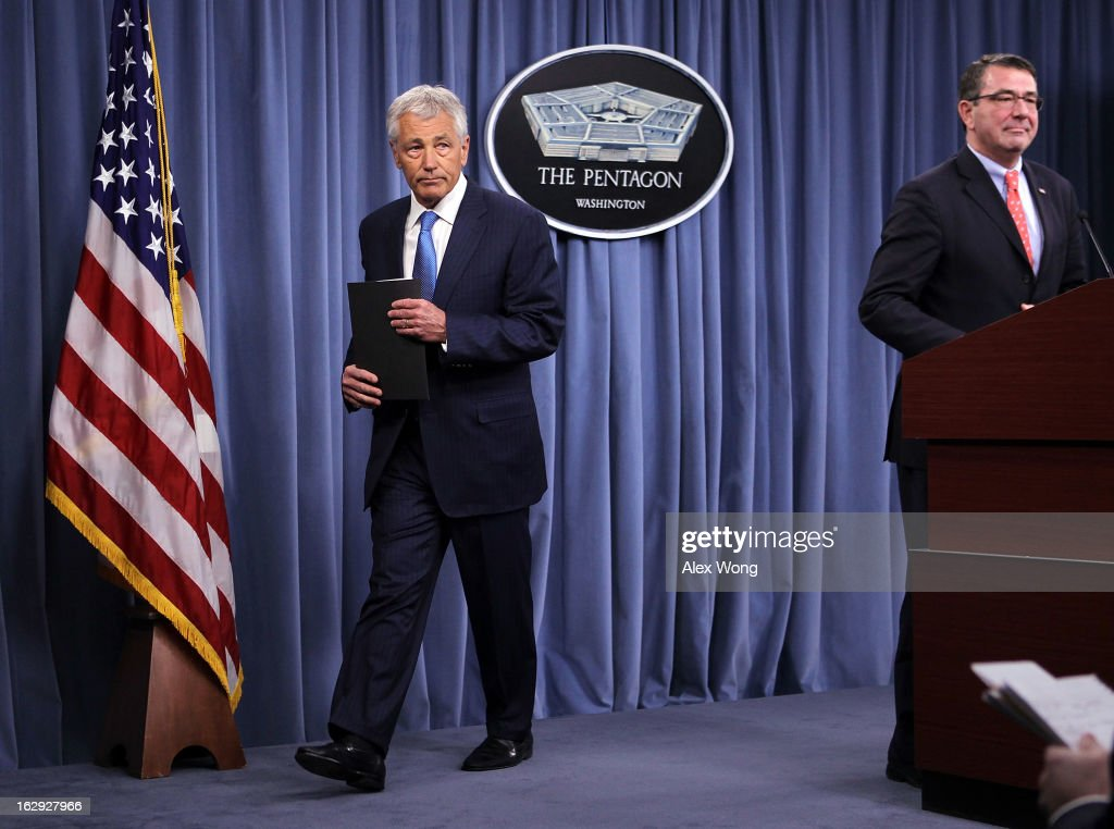 U.S. Secretary of Defense <a gi-track='captionPersonalityLinkClicked' href=/galleries/search?phrase=Chuck+Hagel&family=editorial&specificpeople=504963 ng-click='$event.stopPropagation()'>Chuck Hagel</a> (L) leaves as Deputy Secretary of Defense <a gi-track='captionPersonalityLinkClicked' href=/galleries/search?phrase=Ashton+Carter&family=editorial&specificpeople=956792 ng-click='$event.stopPropagation()'>Ashton Carter</a> takes over during a news briefing March 1, 2013 at the Pentagon in Arlington, Virginia. Secretary Hagel spoke on the impact of the sequestration to the Department of Defense.