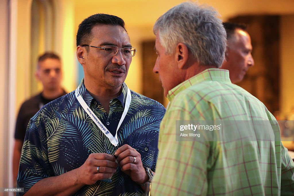 U.S. Secretary of Defense Chuck Hagel (R) listens to Malaysian Defence Minister and acting transport minister Hishammuddin Hussein (L) during a welcome reception for Southeast Asian defense ministers April 1, 2014 in Honolulu, Hawaii. Secretary Hagel is in Hawaii to host a meeting of defense ministers from the Association of Southeast Asian Nations (ASEAN) on April 1 to 3.