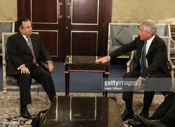S Secretary of Defense Chuck Hagel meets with Egyptian Foreign Minister Nabil Fahmy during the IISS 2013 conference at the Ritz Carlton on December 7...